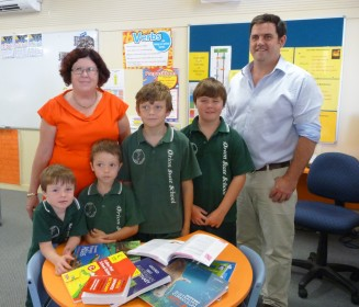 Orion School Principal Sue Cannon and Philp Brodie Grain Merchant Ben Hardy with Orion Primary School students