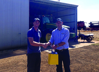 Victorian grower Alistair Woods receives the Paspaley voucher from SQP Grain Merchant Tim Hayes